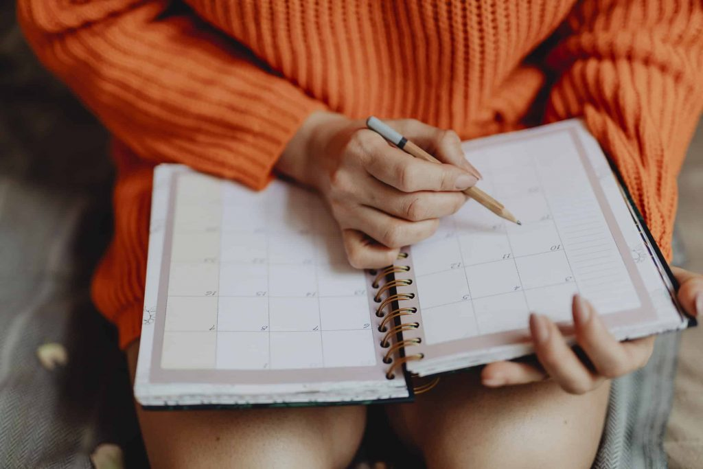 Girl planning in calendar