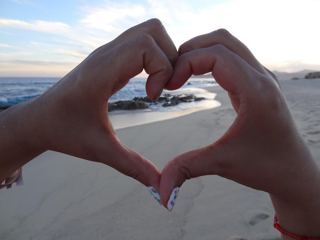 hands in a shape of heart, beach, water, sand, sunset