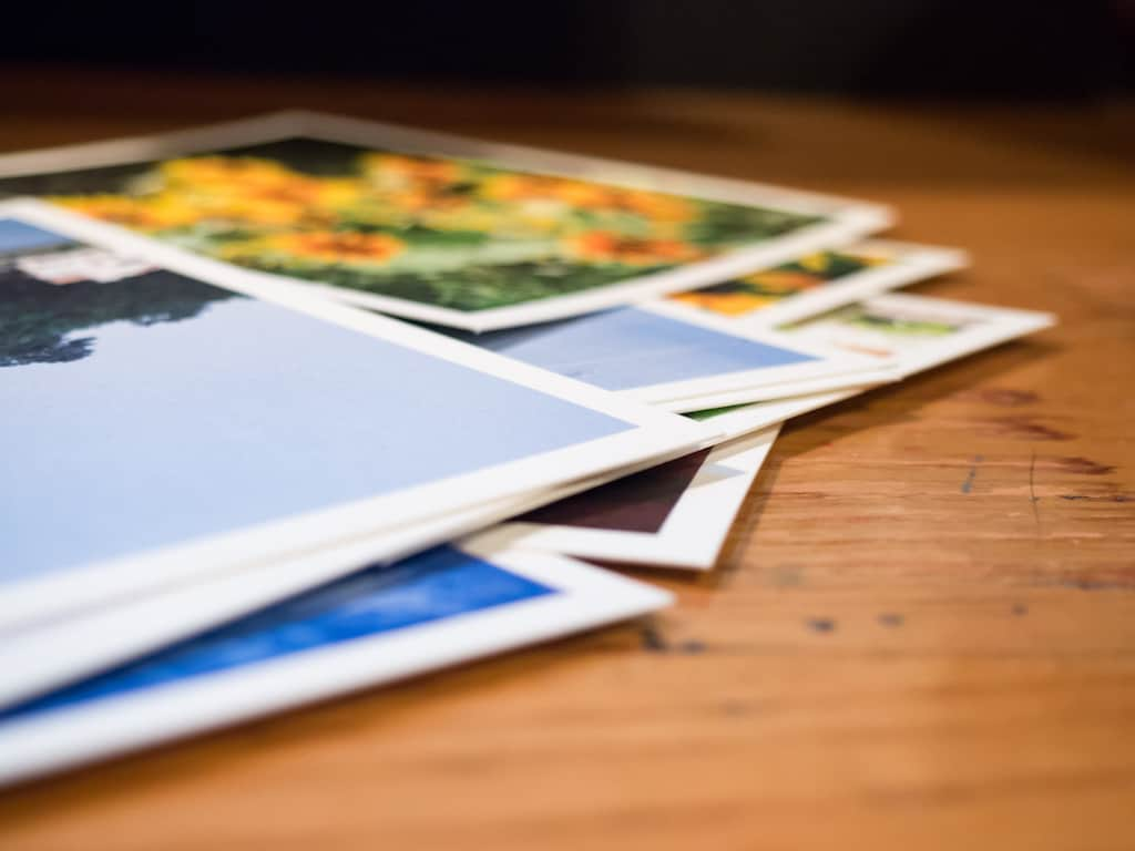photos, lot of pictures on a wooden table