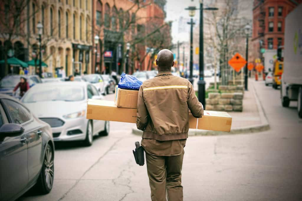 delivery, boxes, man on a street