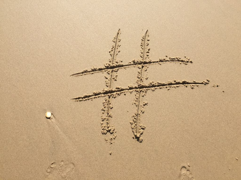 hashtag written in the sand