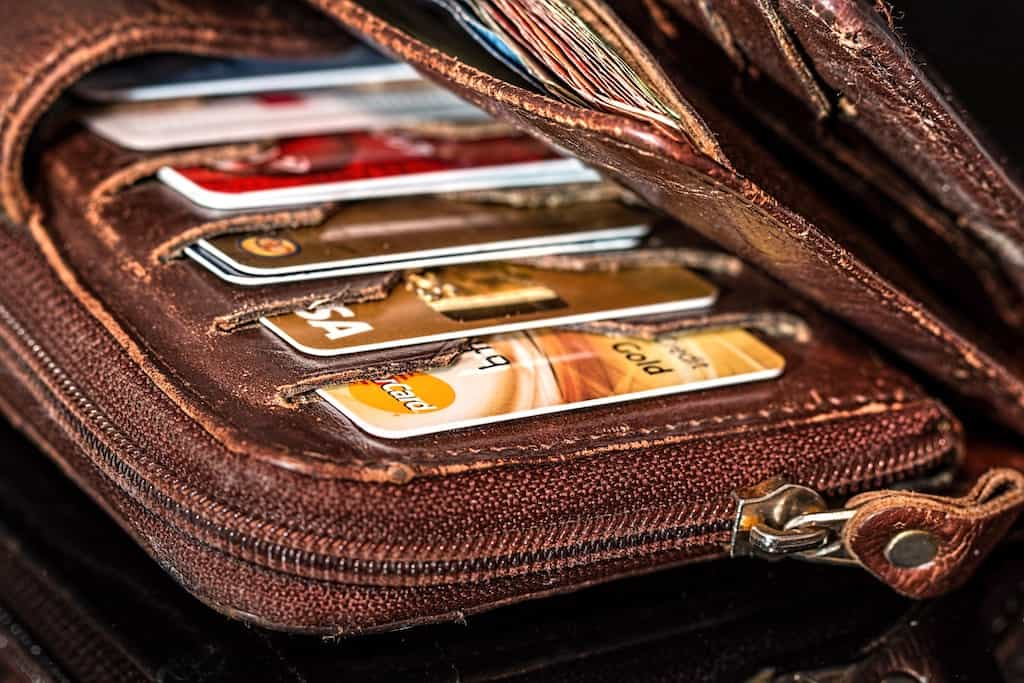 brown leather wallet with a credit cards inside