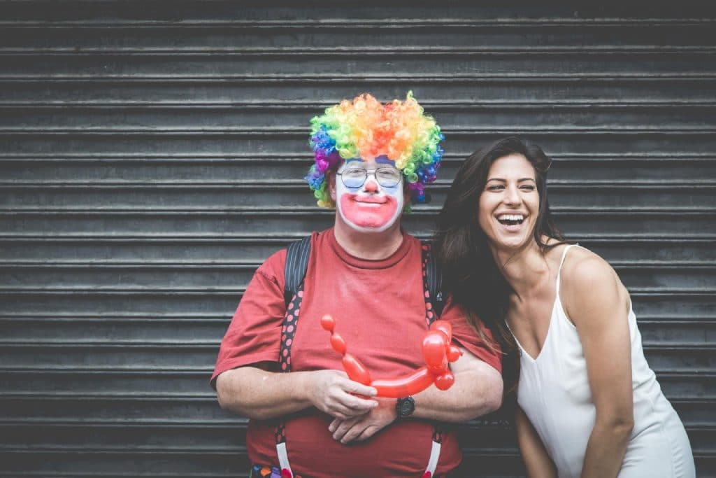 clown and woman laughing