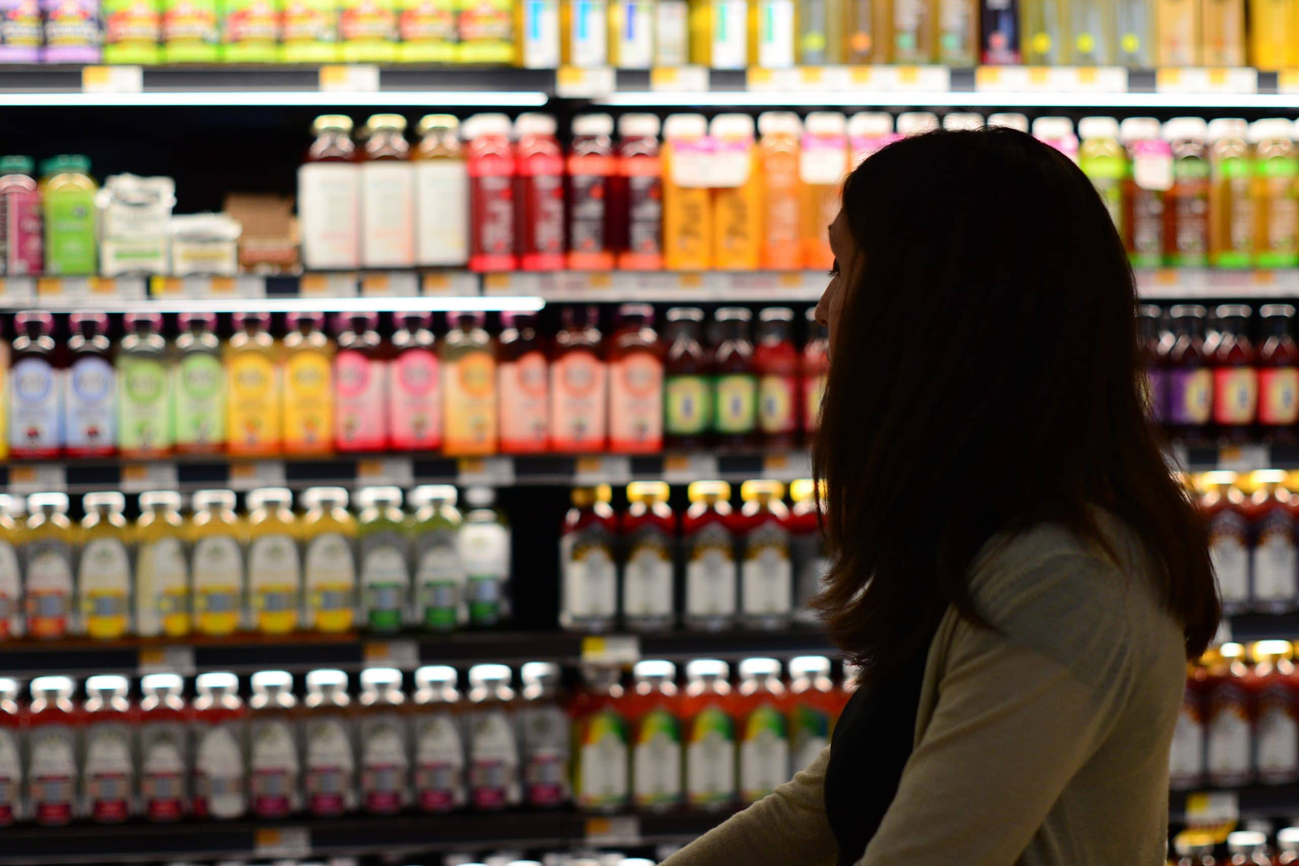 woman looking in a grocery store