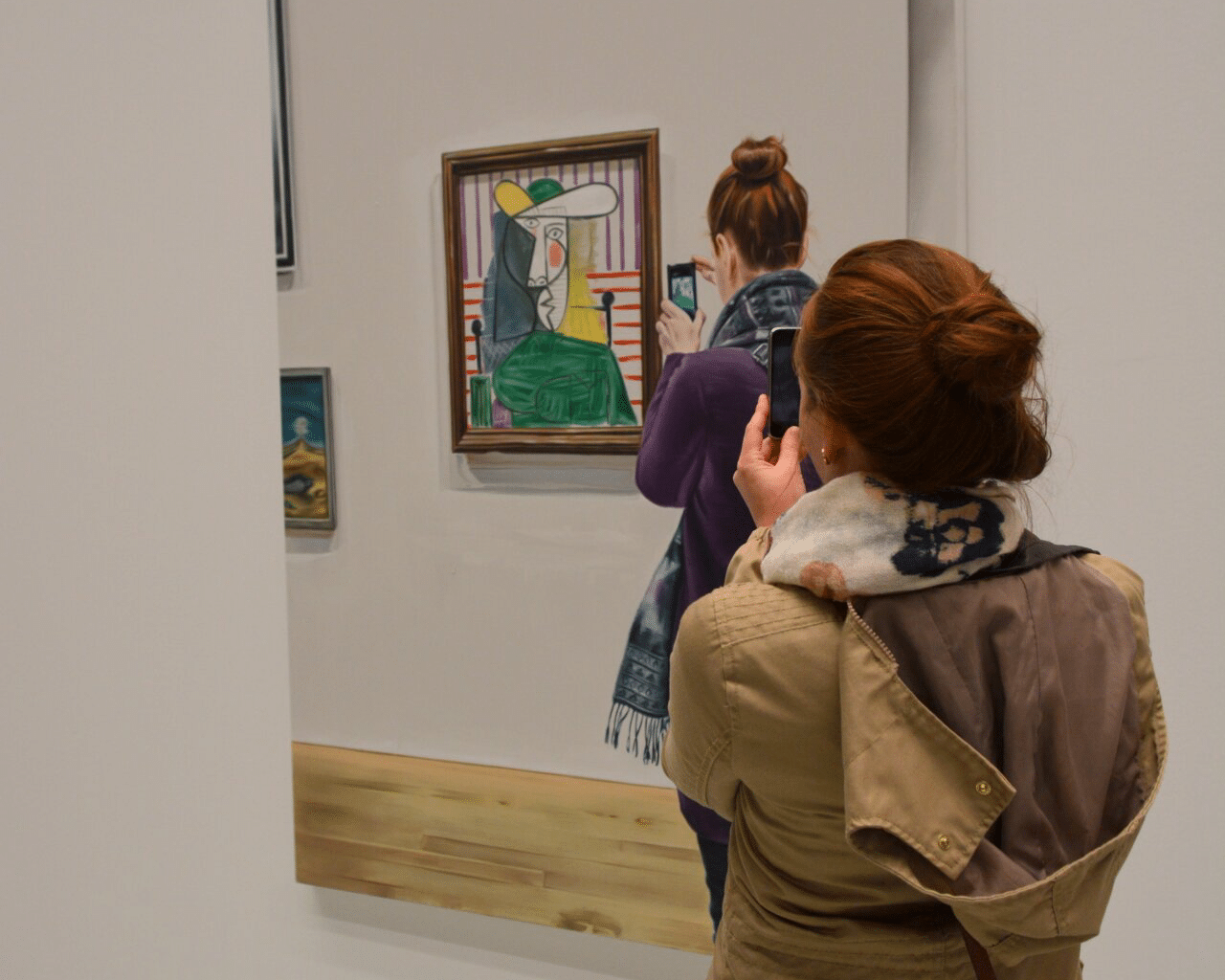 woman taking pictures in a gallery