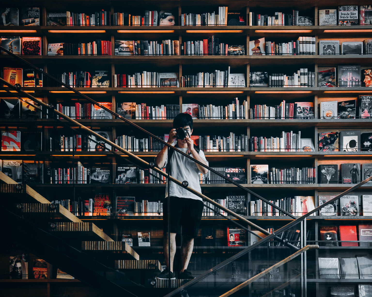 Man with a camera in a library