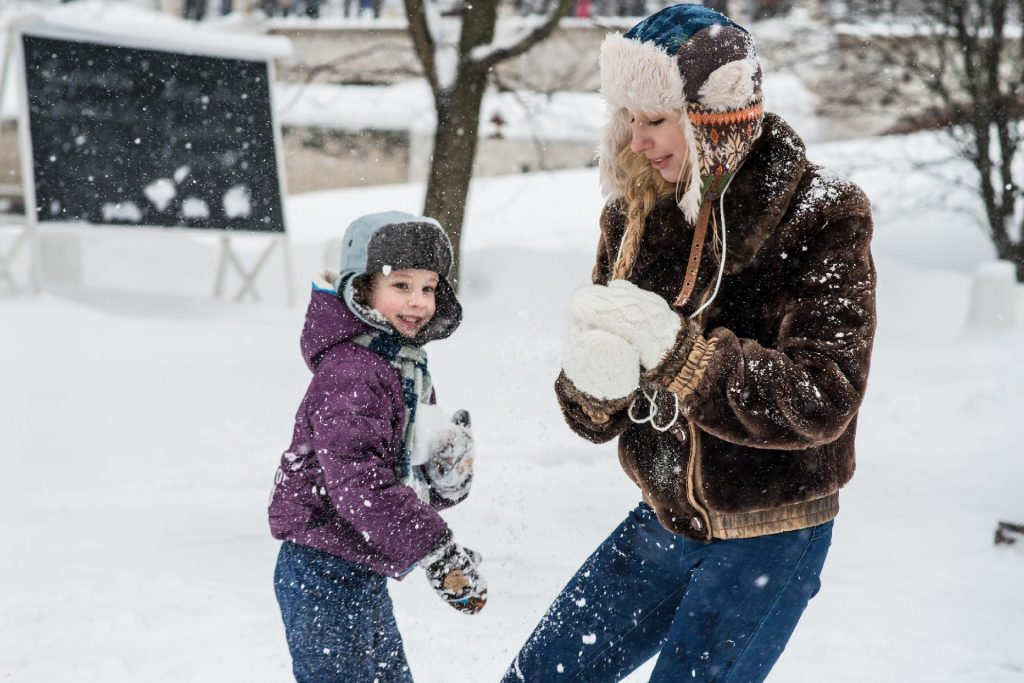 kids interacting with snow
