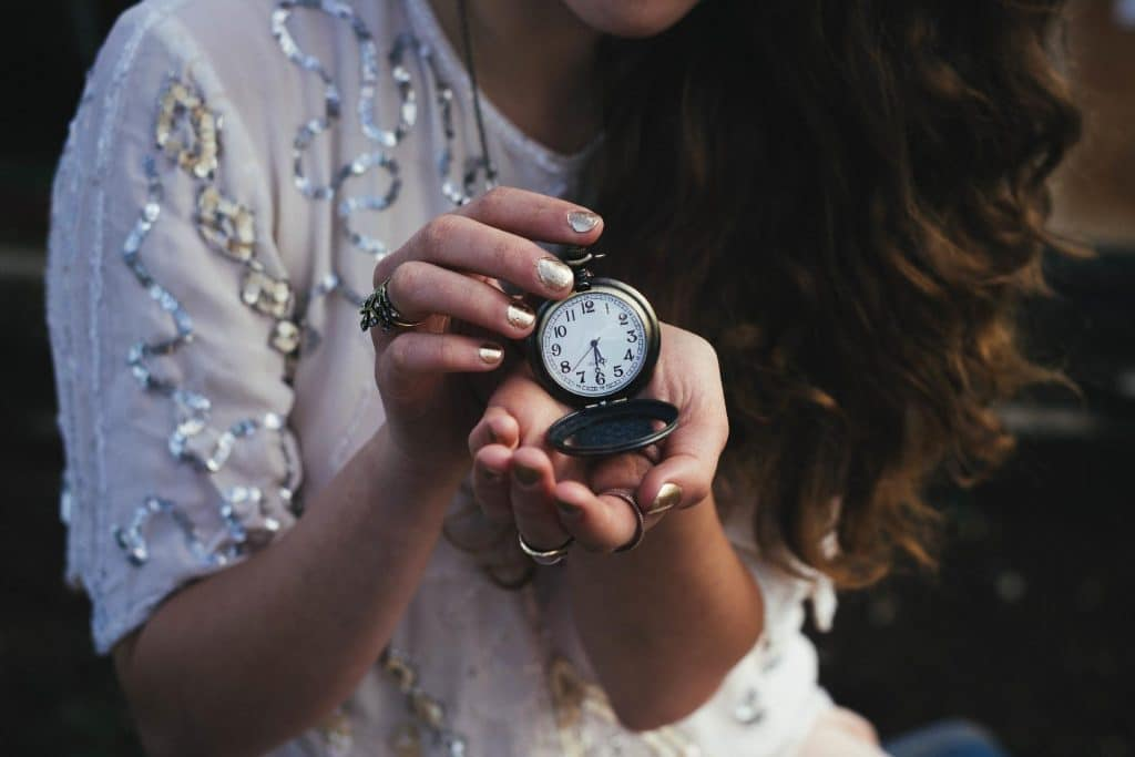 Girl checking time with a clock