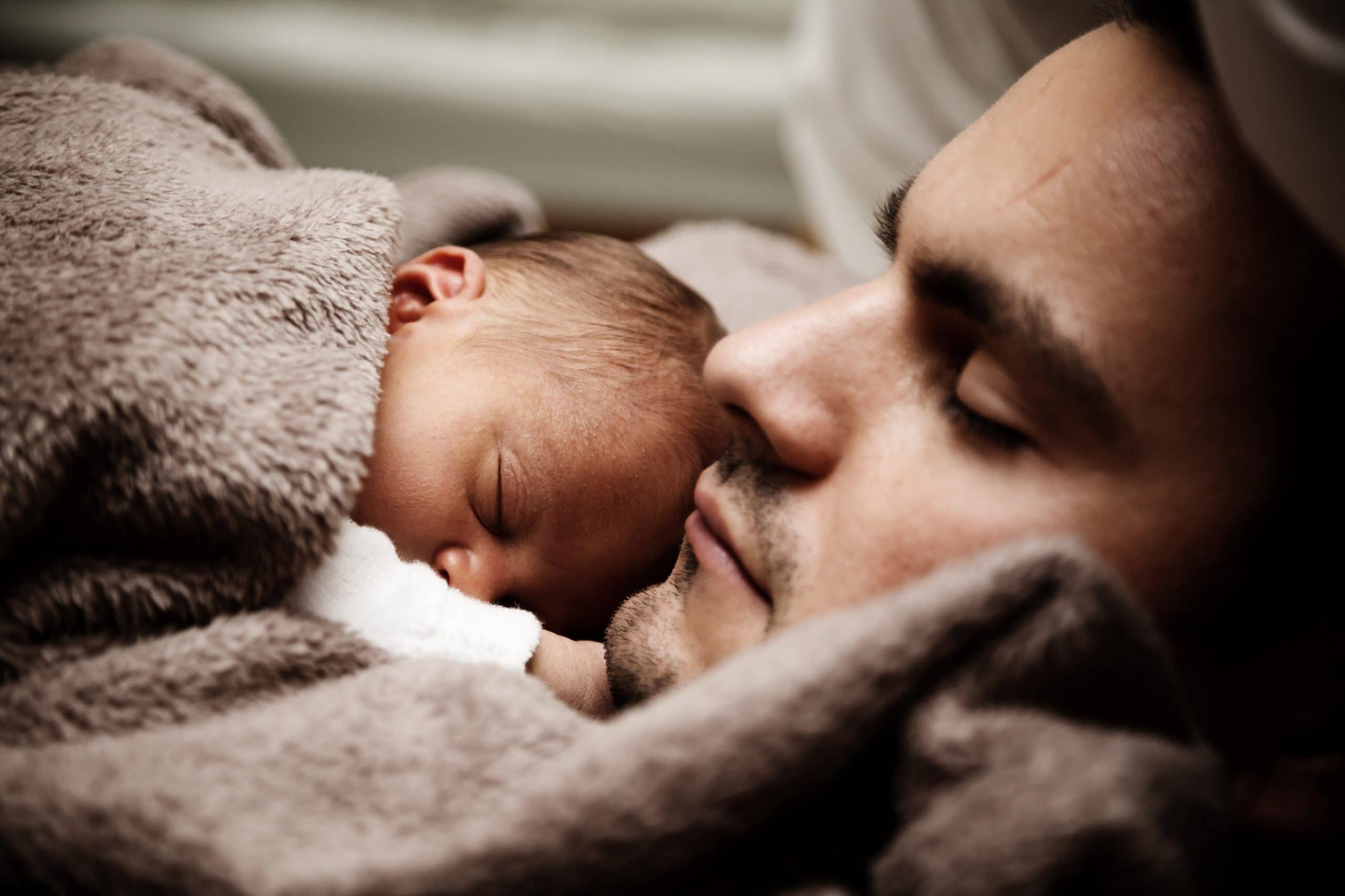 Father with baby sleeping