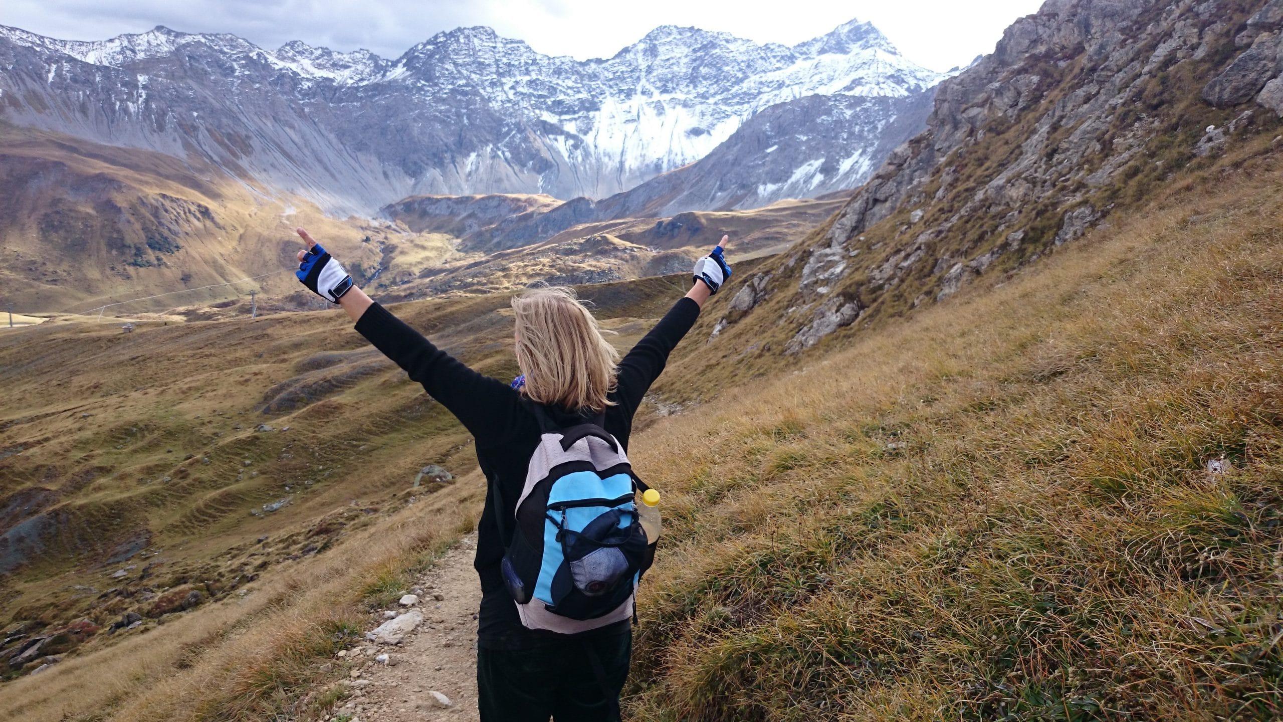 woman celebrating hiking