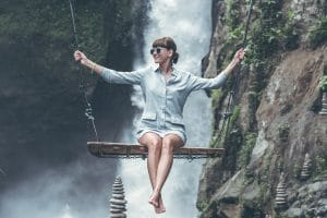 stock photography of a girl on a swing