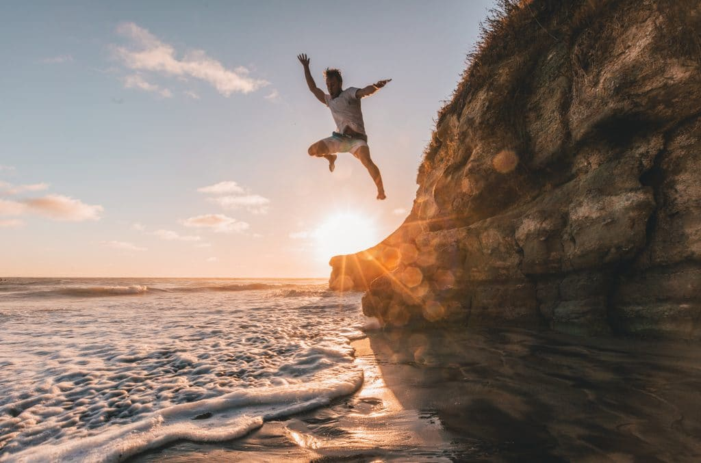 guy jumping on the beach