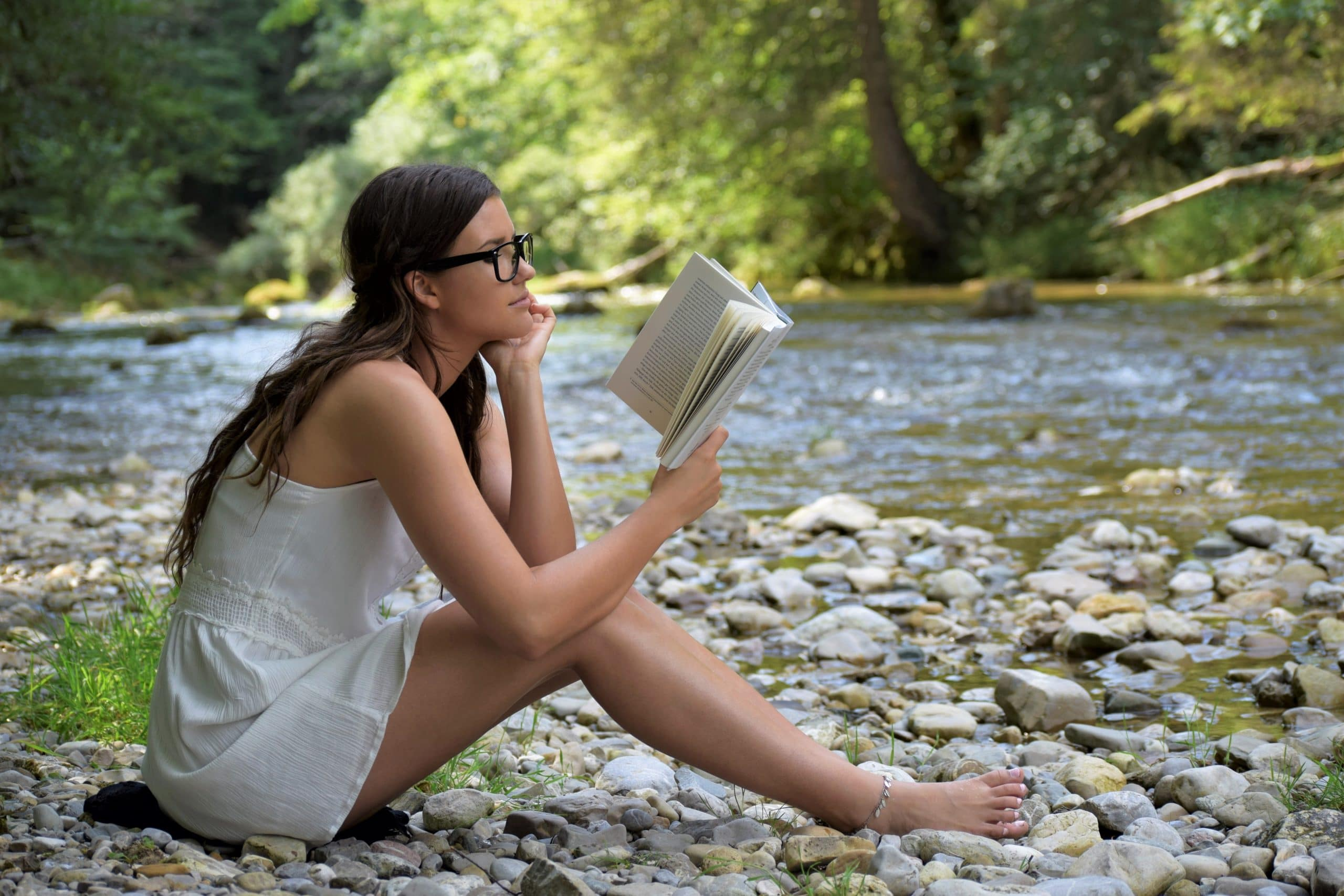 Girl studying neuromarketing next to a river