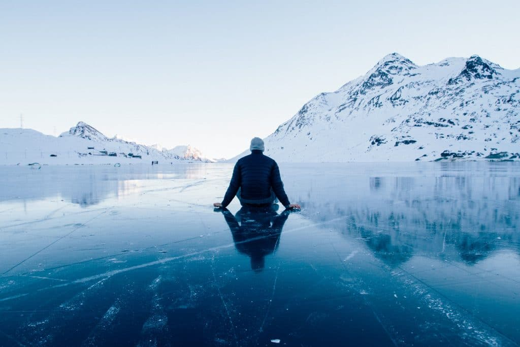 Man sitting on ice