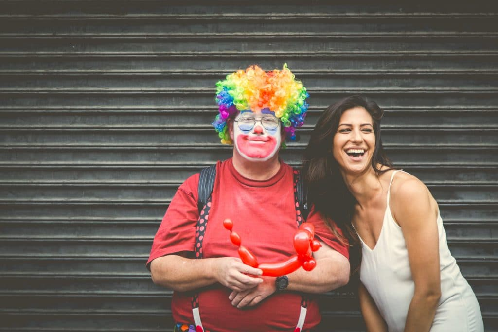 woman and a clown