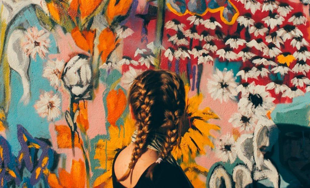 woman looking at a graffiti