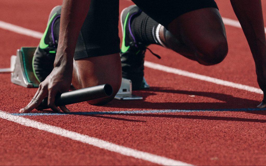 person starting a run